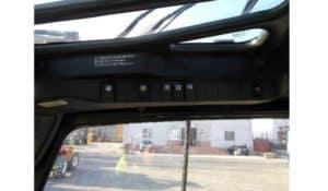 plafoniera con tasti di funzionamento delle luci e servizi ausiliari
